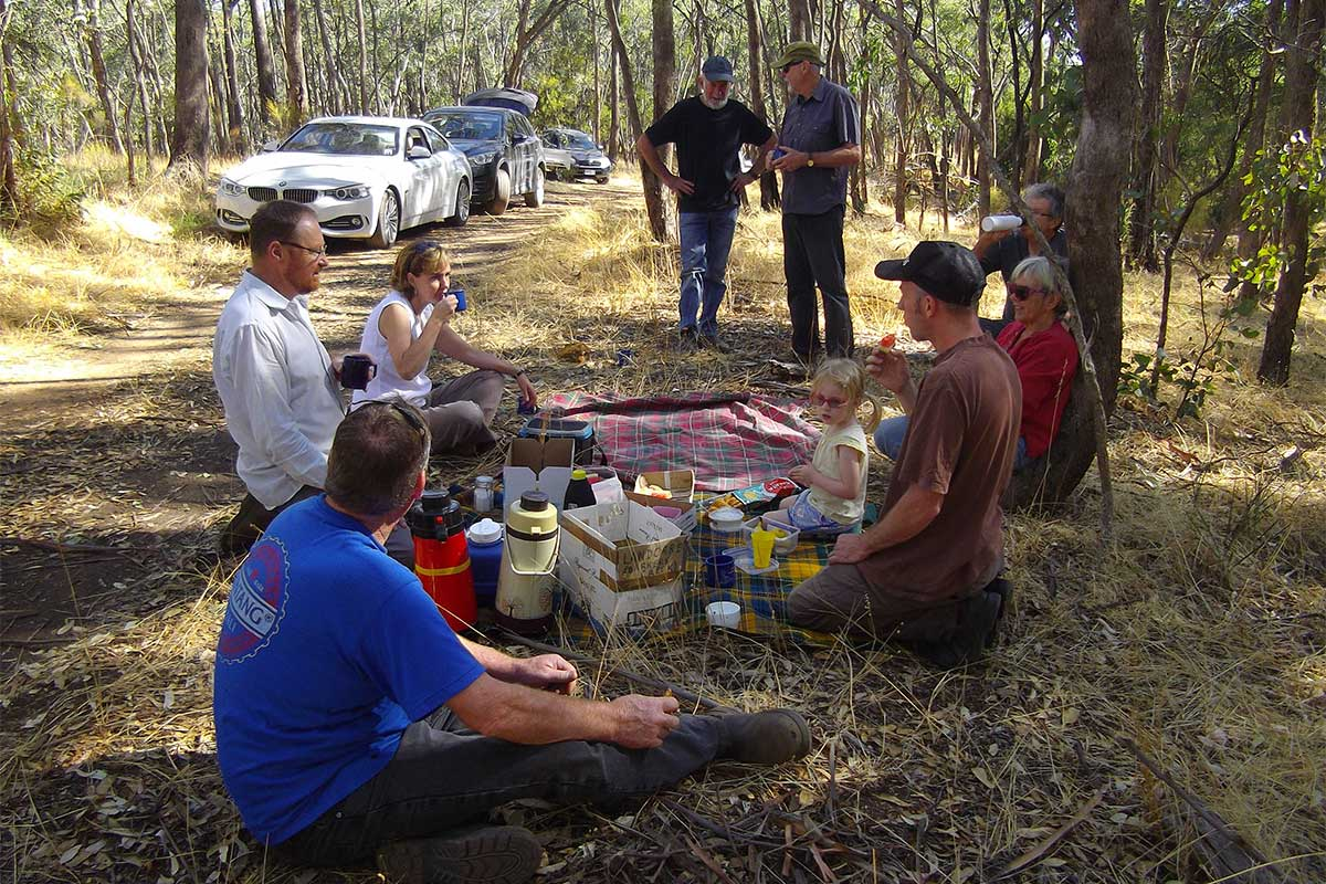 Group having morning tea picnic